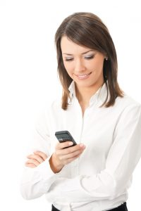 Happy smiling successful businesswoman with cell phone